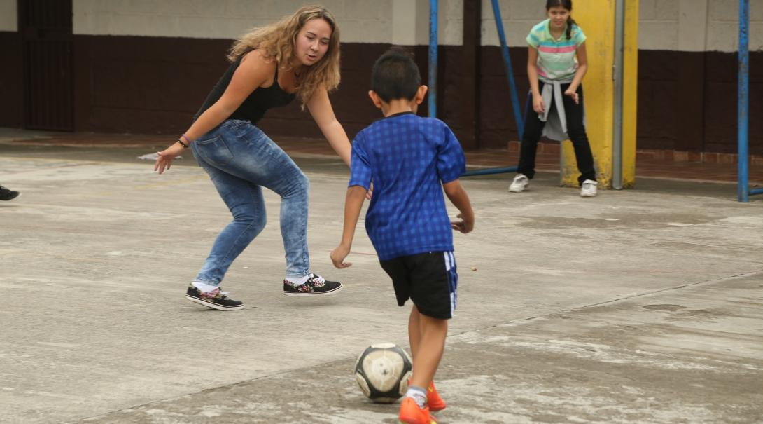 A volunteer teaching sports in Argentina plays ball sports with local children